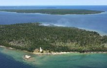 Firefighters on Poverty Island work to contain wildfire, save lighthouse