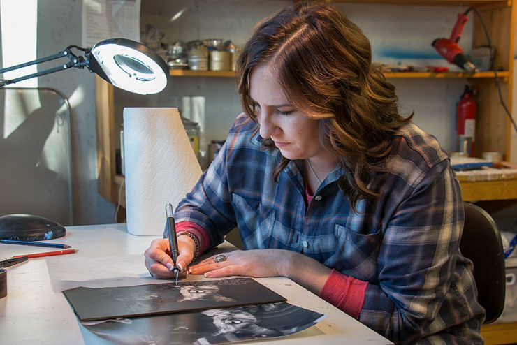 Intricate scratchboard art reveals insights of Rapid River artist