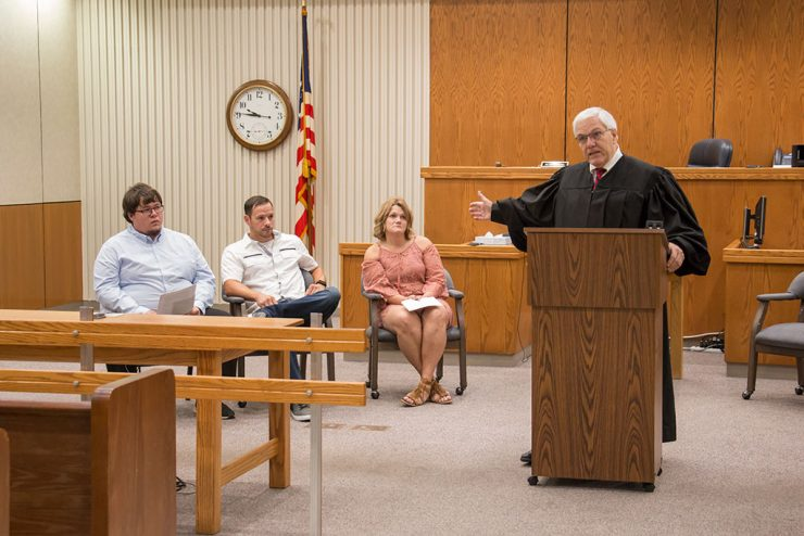Three more facing court charges graduate from Delta County Drug Court