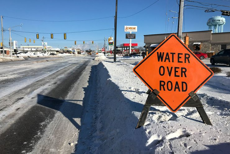 Residents asked to limit water usage as major water main break floods Escanaba