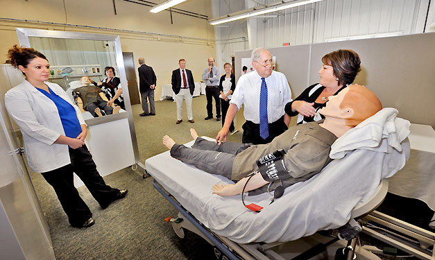 Jodi Orm, right, a nursing professor at LSSU, demonstrates a mannequin's features for U.S. Senator Carl Levin during a tour of Sault Ste. Marie's newly-opened SmartZone technology accelerator building.