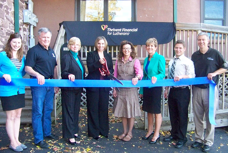 Attending the ribbon cutting celebration at Thrivent Financial's new Marquette location were (from left to right): Betsy Morais, LSCP Director of Marketing & Communications, Sam Elder, Marquette County Ambassador, Shelby Bischoff, Executive Director of Marketing & Business Development, Theresa Sell, Owner/Financial Consultant, Noreen Heitman, Executive Assistant, Chris VanAbel, Marquette County Ambassador, Derek Bush, LSCP Business Development Representative and Dave Puskala, Marquette County Ambassador.