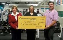 Thrivent Financial presents check to YMCA of Marquette County