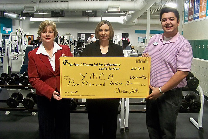 Thrivent Financial presents a check to the YMCA of Marquette County. Attending the presentation (from left to right) were Thrivent Financial Office Professional, Shelby Bischoff, Thrivent Financial Consultant, Theresa M. Sell and YMCA Community Engagement Leader, Matt Deal.