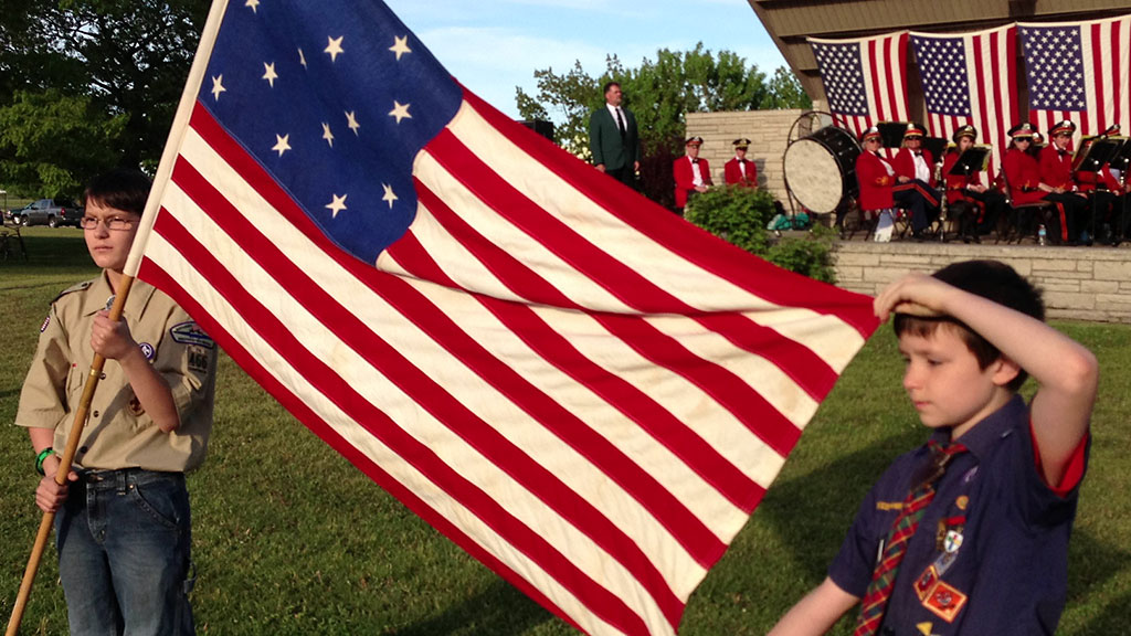 Scouts from troop 466 in Gladstone display a historical flag at the annual Elks Flag Day program in 2013 at Ludington Park in Escanaba. This year's program will be Saturday at 7 p.m.