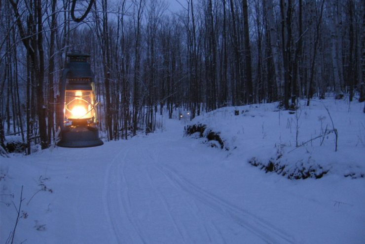 Winter U.P. snowshoe, cross-country ski trails lantern-lit at state parks
